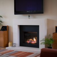 Bespoke-limestone-fireplace-with-Gazco-Riva-2500-gas-fire