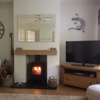 Stovax-wood-burner-with-oak-fascia-beam-and-slate-hearth