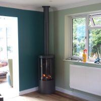 Freestanding Fireplace in Corner of Room