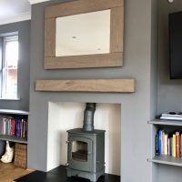 Cove 1 Fireplace with a Gunmetal Finish in a Living room