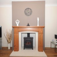 Electric Stockton Fireplace in a Varnished fireplace mantle