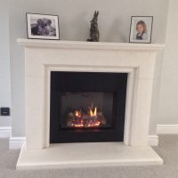 Marble Mantle around a Wood Burning Fire