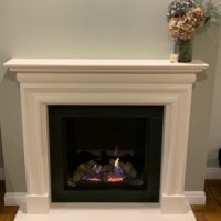Adding A New solid natural limestone fireplace